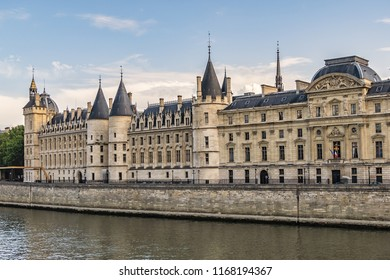 Castle Conciergerie - former royal palace and prison. Conciergerie located on the west of the Cite Island and today it is part of larger complex known as Palais de Justice. Paris, France. Sunset.