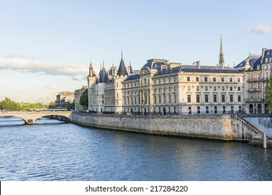 Castle Conciergerie - former royal palace and prison. Conciergerie located on the west of the Cite Island and today it is part of larger complex known as Palais de Justice. Paris, France. At sunset.