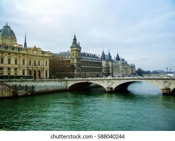 Castle Conciergerie and Paris bridge over river seine, view of the river in Paris