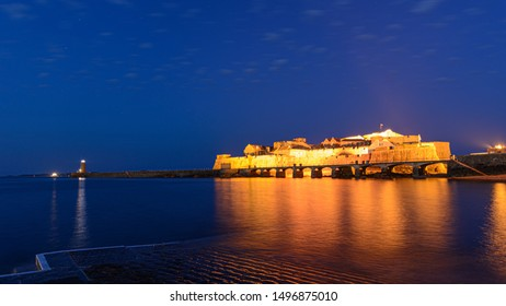 castle cornet st peter port guernsey at night
