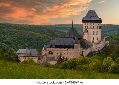Karlštejn Castle (Czech: hrad Karlštejn; German: Burg Karlstein) is a large Gothic castle founded in 1348 by Charles IV, Holy Roman Emperor-elect and King of Bohemia. - Shutterstock ID 1943489476