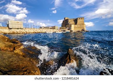 Castle dell ovo or castel dellovo famous historical mediterranean coast fortress port tourism old medieval building landmark in Naples Italy Campania landscape panorama