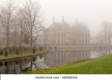 Castle Duivenvoorde Voorschoten, Netherlands, in the fog.