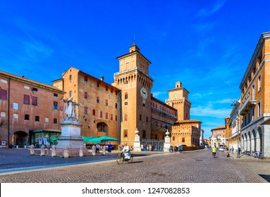 Castle Estense (Castello Estense) and piazza Savonarola and monumet to Savonarola in Ferrara, Emilia-Romagna, Italy. Ferrara is capital of the Province of Ferrara