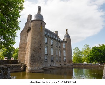 The castle of Flers, now a history museum (Normandy, Orne, France). Beautiful medieval architecture.  Historical monument. Surrounded by a moat. Sunny day. June 2020.