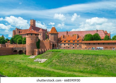 Castle fortifications of the Teutonic Order in Malbork from East. Malbork Castle is is the largest castle in the world measured by land area.