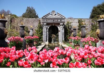 Castle gardens at Arundel castle. Tulips in flower beds in formal ornamental park