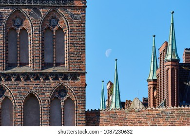 Lübeck, the castle gate during the day with moon