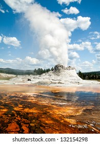 Castle Geyser erupts Yellowstone's Upper Geyser Basin not far from Old Faithful Geyser.