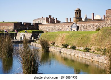 The Castle of Good Hope is the oldest building in Cape Town, South Africa. The old fortress is surrounded by a moat with the original entrance to the right.