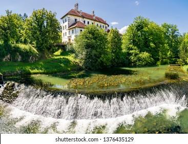 Castle Gradac overlooking Lahinja river in Bela krajina, southeastern Slovenia. - Shutterstock ID 1376435129