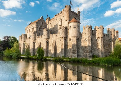 Castle Gravensteen, Ghent. Medieval castle Gravensteen (Castle of the Counts) in Ghent, Flanders, Belgium. Legendary castle with small windows surrounded by water in moat in Ghent, Flanders, Belgium.