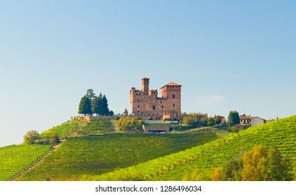 Castle of Grinzane Cavour surrounded by vineyards in the Langhe region, Piedmont, Italy