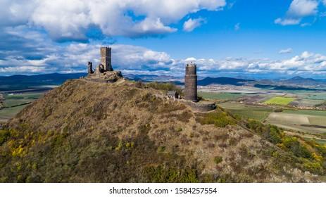 Castle Hazmburk. Ruines of Hazmburk castle on top of mountain peak of Ceske Stredohori range.  Medieval castle with views on czech countryside landscape near village Klapy, Libochovice, Czech Republic