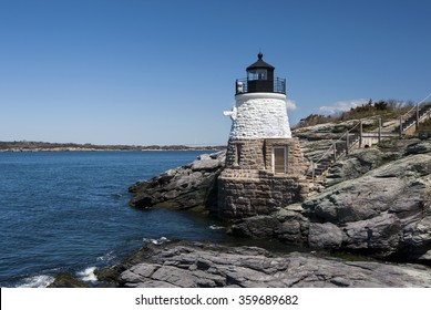Castle Hill lighthouse is constructed on rocky ledges and small cliffs to guide mariners into Narragansett Bay in Newport, Rhode Island.