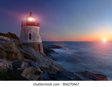 Castle Hill Lighthouse at sunset with setting sun