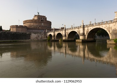 Castle of Holy Angel and Holy Angel Bridge over the Tiber River in Rome at Dawn, Italy