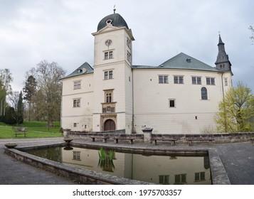 Castle Hruby Rohozec in Turnov above pool with fountain and koi carps. Turnov, Czech Republic - Shutterstock ID 1975703357