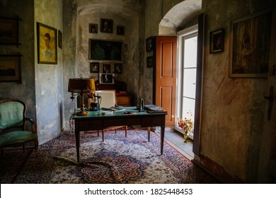 Castle interior. An office with a desk and an armchair. Antique lamp and telephone. Pictures and photos on the walls.  Jezeri, Northern Bohemia, Czech Republic, September 19, 2020