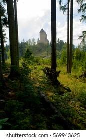 Castle Kasperk in the woods on a sunny day.