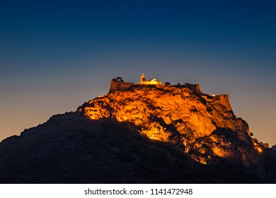 """The castle of Kyhtera island, Greece at night. It is the most characteristic monument of Chora town. The castle """"Fortezza"""" was built in the 13th century when Kythera was dominated by the Venetians"""