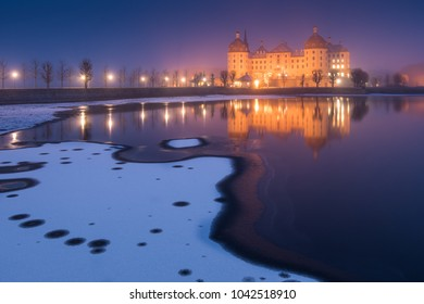 The castle in Moritzburg on a snowy evening in winter, Saxony in Germany