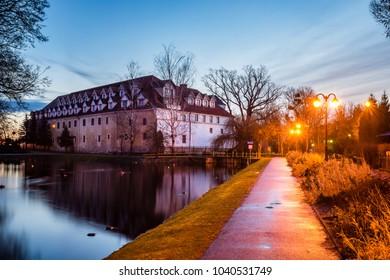 Castle at night in Wegorzewo city, Masuria, Poland