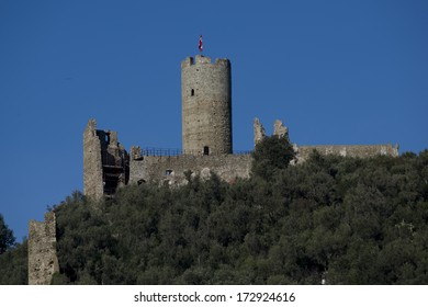 The castle on the hill over Noli, typical village of the ligurian riviera in Italy