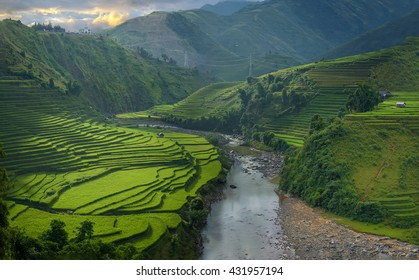 Castle on mountain surrounded with rice fields and river flow