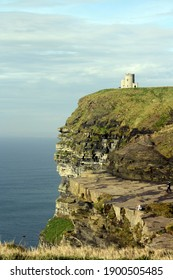 Castle on top of Cliffs of Moher, Ireland. Breathtaking scenery with cliff, rocks, blue skies and green grass.