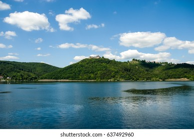Castle on top of hill at Edersee Germany sea water sky