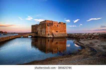 The castle of Paphos early in the morning with reflection on the water, Cyprus