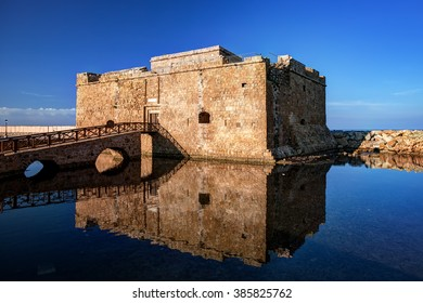 The castle of Paphos in the morning with reflection on the water, Cyprus