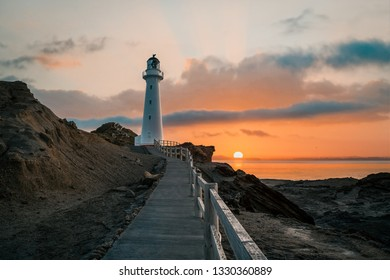 Castle Point lighthouse, located near the village of Castlepoint in the Wellington Region of the North Island is the best place to witness the sunrise.