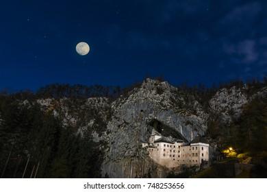 Castle Predjama and full moon