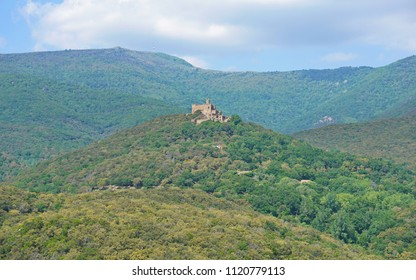 The castle of Requesens on the top of the hill with the peak Neulos in background, Albera massif, la Jonquera, Alt Emporda, Girona, Catalonia, Spain