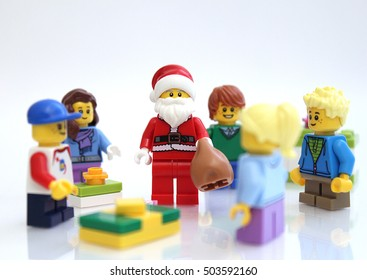 Castle Rock, Colorado, USA - October 24, 2016: Studio shot of LEGO minifigure Santa Claus with children in Christmas scene.