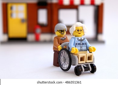 Castle Rock, Colorado, USA - September 20, 2016: Studio shot of LEGO minifigure old man and old woman in wheelchair. Scene representing growing old together.