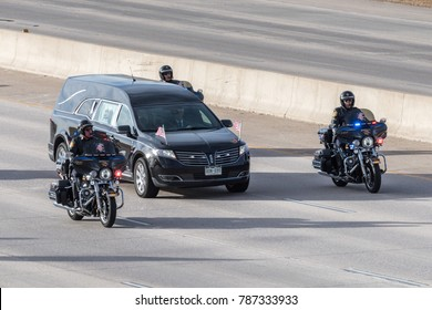 CASTLE ROCK, COLORADO/USA - JANUARY 5, 2018: Motorcycle escort of the hearse during the funeral procession on Interstate-25 for Douglas County Deputy Sheriff Zackari Parrish.