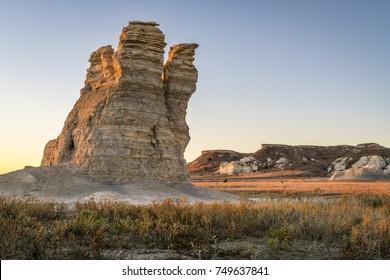 Castle Rock  - limestone pillar landmark in prairie of western Kansas near Quinter (Gove County) at late October sunrise