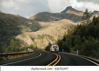 CASTLE ROCK, WA - SEPTEMBER 21: A '70s GMC Royale Motorhome six-wheeler camper van drives around the Mount St. Helens National Volcanic Monument in Castle Rock, Washington on September 21, 2016.
