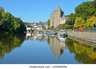 Castle of Rohan on the banks of Oust, part of canal Nantes at Brest, at Josselin, a commune in the Morbihan department in Brittany in north-western France