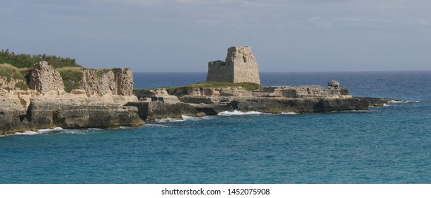 Castle ruins and lookout Tower overlooking the Adriatic sea in Roca in Salento. Roca is an important archaeological excavations site and a touristic center in Salento.