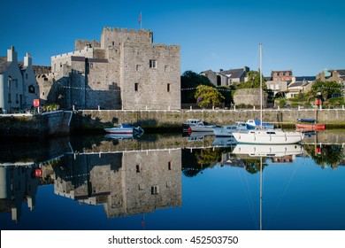 Castle Rushen in Castletown in the Isle of Man, with reflections in the harbor