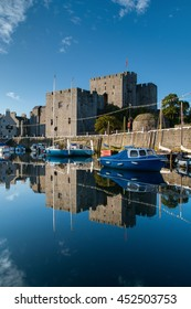 Castle Rushen in Castletown in the Isle of Man, with reflections in the harbor - portrait orientation