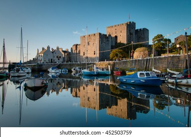 Castle Rushen in Castletown in the Isle of Man, with reflections in the harbor - taken shortly after sunrise
