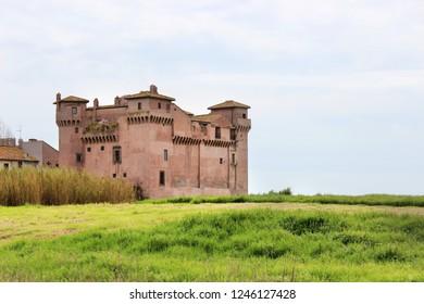 the castle of Santa Severa on a cold winter day. The cloudy white sky. In Lazio, Italy, Rome