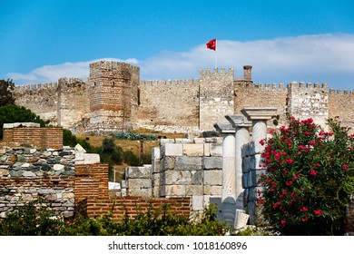 Castle in Selcuk with Turkish flag, Ayasuluk hill. Turkey