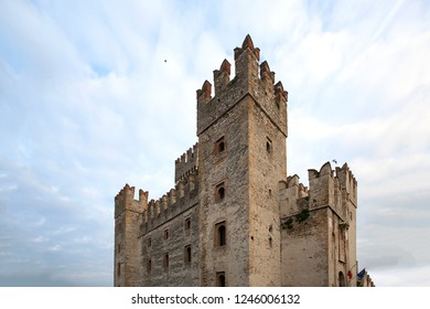 Castle in Sirmione - November 15, 2015 : View to the medieval Rocca Scaligera castle in Sirmione town on Garda lake, Italy. Scaliger Castle (13th century) in Sirmione on Garda lake near Verona, Italy