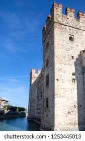 Castle in Sirmione - October 2, 2018: View to the medieval Rocca Scaligera castle (13th century) in Sirmione town on Garda lake near Verona, Italy. Access point to the historical center of Sirmione.